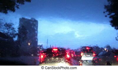 Driving on a rainy street in Bangko