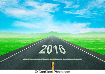 Driving on an empty road to upcoming 2016 new year