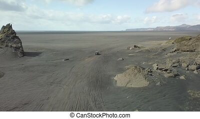 Driving on black sand drone footage