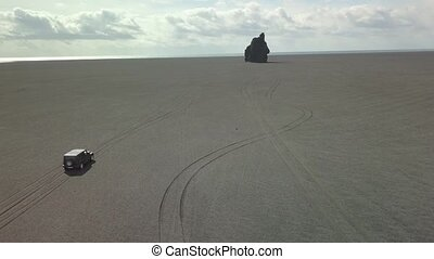 Driving on black sand drone footage - Four wheel drive...