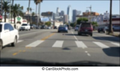 Driving on downtown streets of Los Angeles, California USA. ...