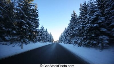 Driving on Highway in winter with sun