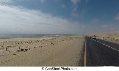 Driving on Luderitz to Walvis Bay coastal Road next to Namib...
