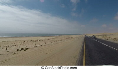 Driving on Luderitz to Walvis Bay coastal Road next to Namib...