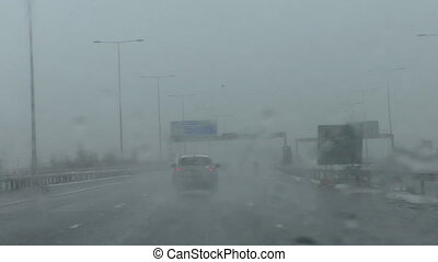 Driving on motorway in sleet - Windscreen or driver's view...