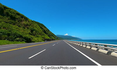 Driving on mountain and coastline highway with blue sky ...