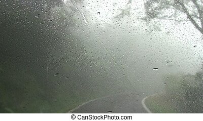 Driving on mountain road in  fog an