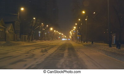 Driving on night road in winter