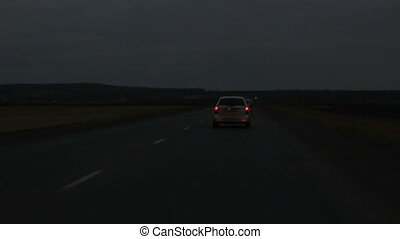 driving on night road with headlights
