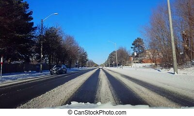 Driving on Snow Covered Road in Day. Driver Point of View...