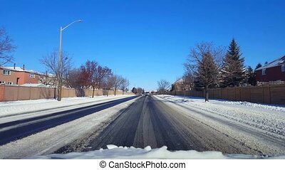 Driving on Snowy Residential Suburb Street in Day. Driver...