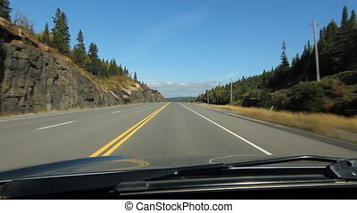 Driving on sunny Ontario highway. - Driving on the trans...