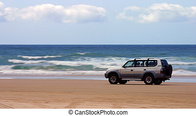 Driving on the beach - Four-wheel-drive SUV moving on a...