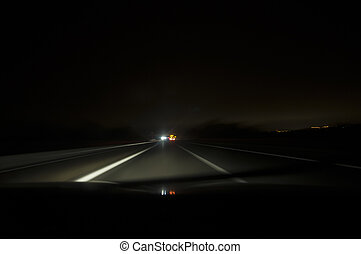 Driving on the night road, motion blur