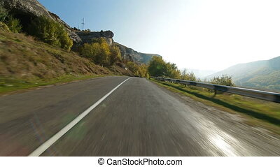 Driving on  winding mountain road