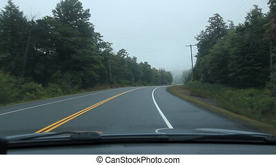 Driving POV in countryside.