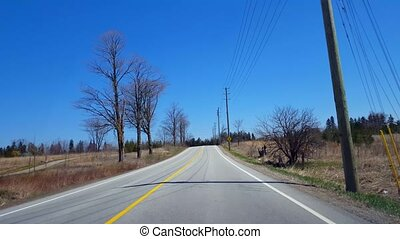 Driving Rural Countryside During Spring Day. Driver Point of...