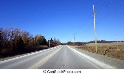 Driving Rural Road During Day. Driver Point of View POV...