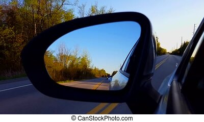 Driving Rural Road View of Side Mirror in Daytime. Driver...