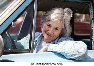 Driving Senior - Smiling senior taking a cruise in the old...