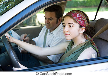 Driving Test - Teen girl taking driving test to get her...