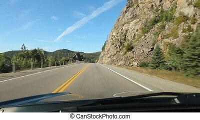 Driving through a rockcut. Ontario. - Driving through a...