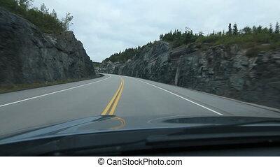 Driving through a rockcut. Ontario, - Driving through a...