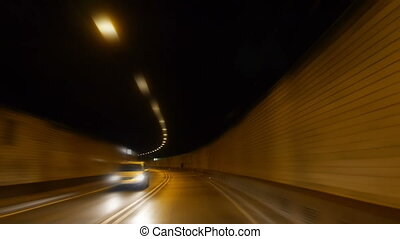 driving through a tunnel by night