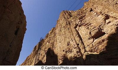 Driving through mountain pass. - Graffiti on mountain cliffs...