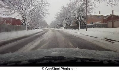 Driving Through Snowy Winter Suburb in Daytime. Driver Point...