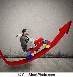 Businessman driving uphill arrow to economic growth
