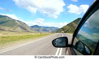 Driving view from side of car mirror mountain gorgeous...
