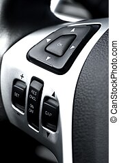 Driving Wheel Sound System and Navigation Buttons. Modern Vehicle Technology and Design. Car Interiors Photo Collection