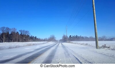 Driving Winter Rural Road in Day. Driver Point of View POV Countryside Street With Snow in Daytime.