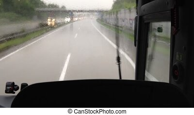 driving with a bus through the rain on the autobahn (german...