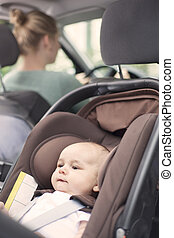 Driving, with baby in a child seat