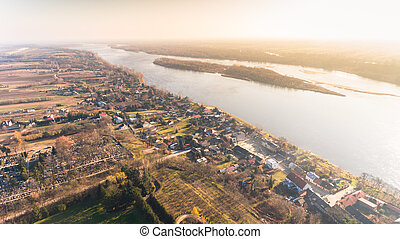 Drone aerial landscape view from above  with village and river in autumn sunset
