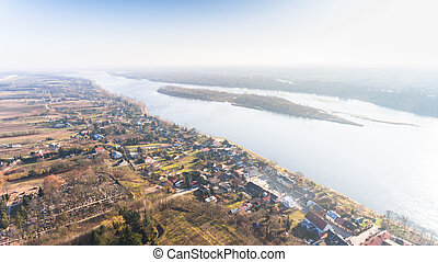 Drone aerial landscape view from above  with village and river in Poland