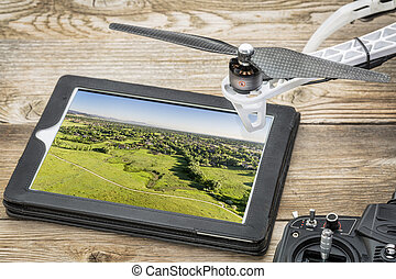drone aerial photography concept - reviewing aerial picture...