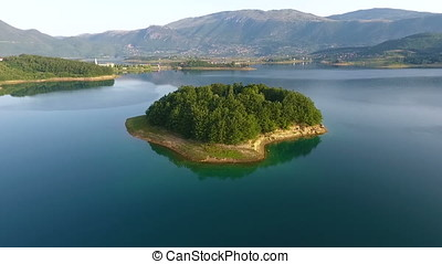 Drone aerial shoot of small island on Ramsko Jezero lake - a...