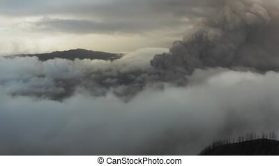 Drone aerial view of active Volcano Bromo. Sunrise, crowd of...