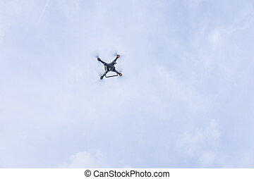 Drone against the blue sky