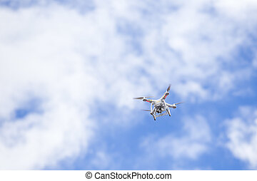 Drone camera on blue sky with cloud.