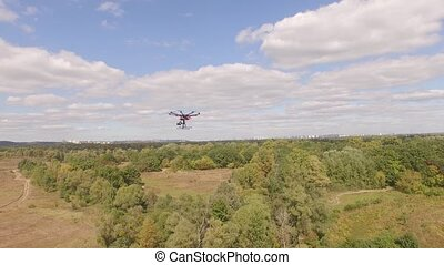 Drone copter UAV - aerial video shooting flying on eight ...