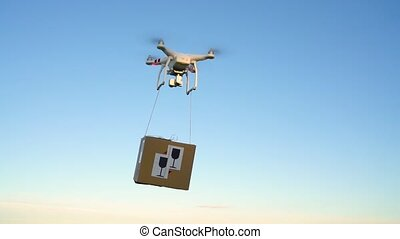 Drone delivering package on the sky background. Slow motion