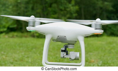 Drone equiped with four rotors and a camera flying in summer...