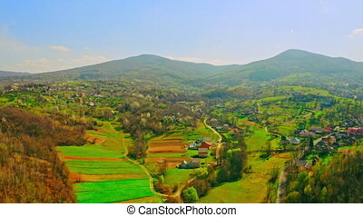 amazing bright aerial view on village in mountains area beautiful calm place in countryside in sunny day spring season
