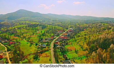 amazing bright aerial view on village located in valley mountains landscape beautiful calm place in countryside in sunny day spring season