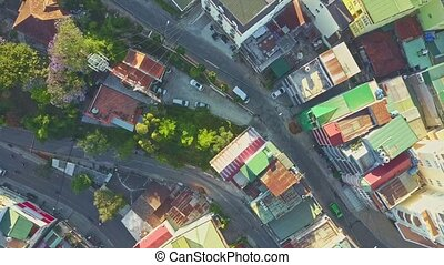 Drone Flies above Streets with Coloured Roofs near TV Tower...