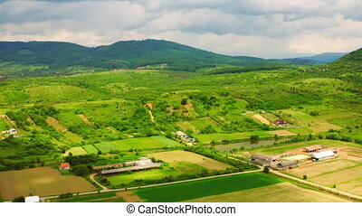 aerial view on rural landscape in mountains area green agricultural field in summer season